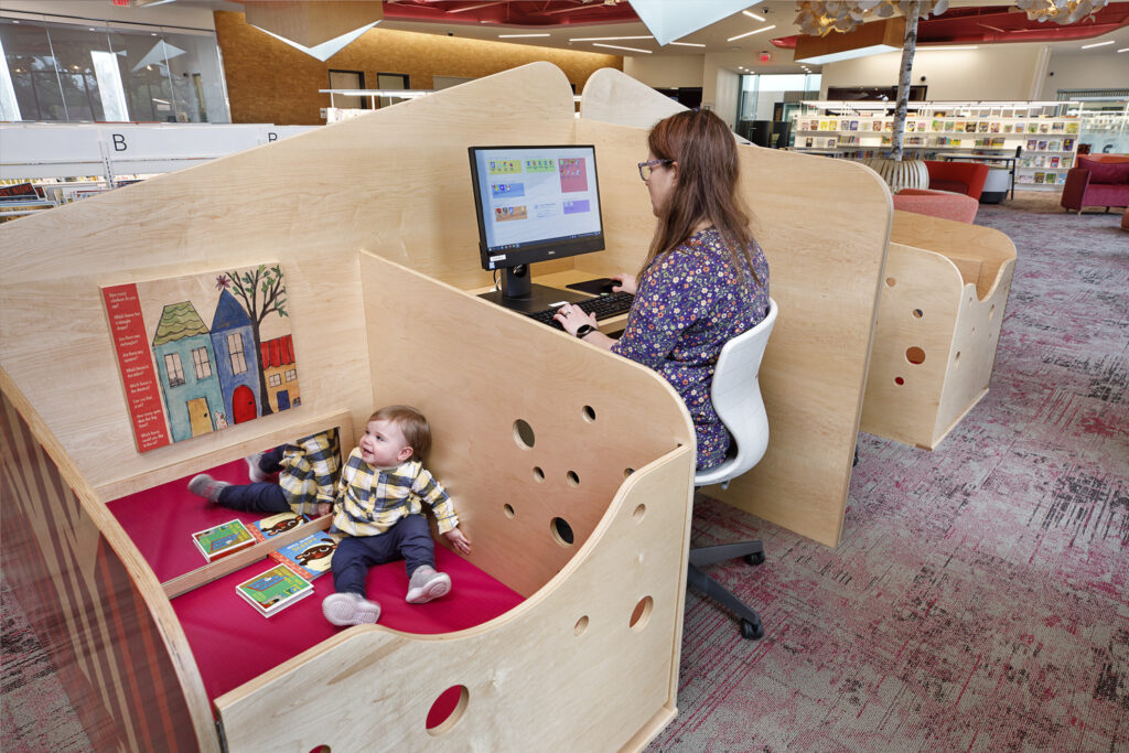 Fairfield library furniture with caregiver and child