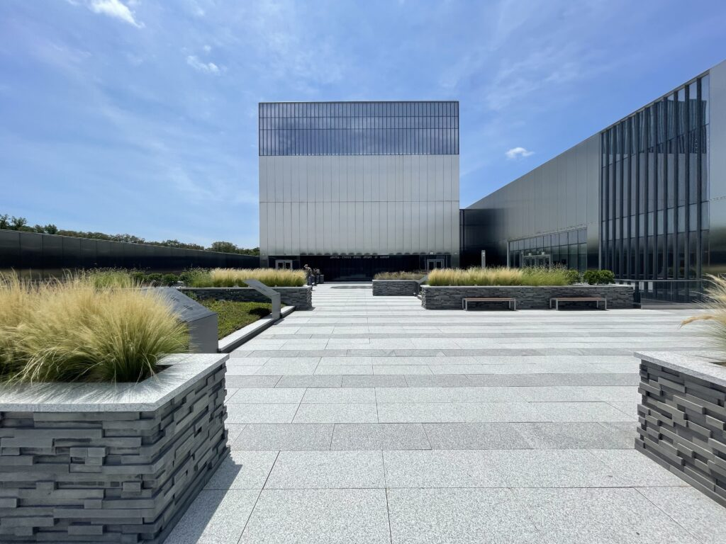 SOM's Arm Museum's rooftop Medal of Honor Garden against a blue sky with clouds